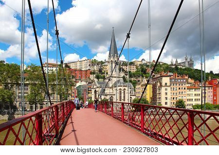 Lyon, France - June 17, 2016: St. Georges Footbridge Over Saone River, St. Georges Church, And Basil
