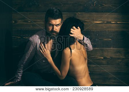 Couple Embracing On Wooden Background