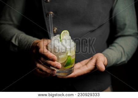 Barman Holding A Glass Filled With A Fresh Mojito Cocktail With Sour And Sweet Taste