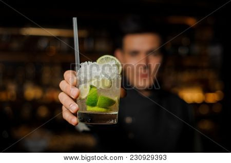 Bartender Holding A Glass Filled With A Fresh Mojito Cocktail With Sour And Sweet Taste