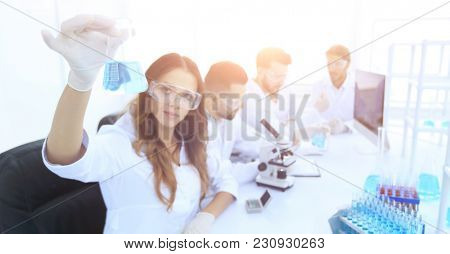 group of young scientists working in the laboratory.
