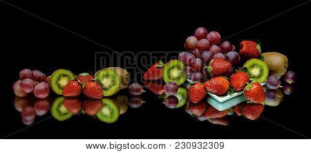Berries And Fruits On A Black Background. Horizontal Photo.