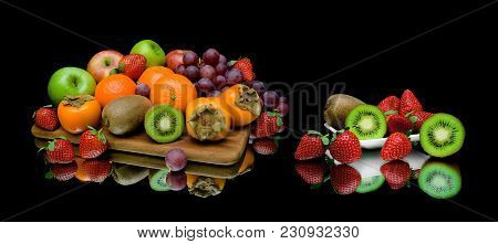 Still Life Of Fruit On A Black Background. Horizontal Photo.