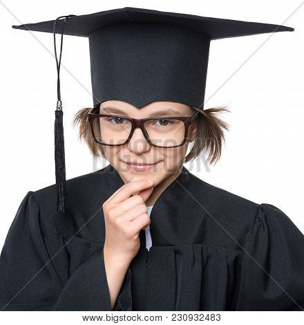 Close Up Portrait Of Thoughtful Graduate Little Girl  Student In Black Graduation Gown With Hat And