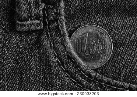 Monochrome Euro Coin With A Denomination Of 1 Euro In The Pocket Of Blue Denim Jeans
