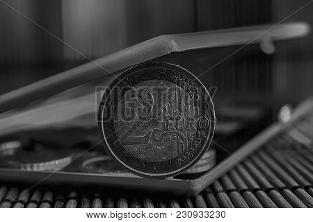 Monochrome Pile Of Euro Coins In Mirror Reflect Wallet Lies On Wooden Bamboo Table Background Denomi
