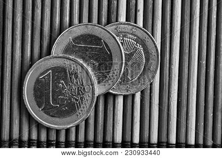 Monochrome Three Euro Coins Lie On Wooden Bamboo Table Denomination Is One Euro