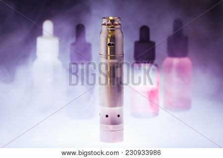 Electronic Cigarette  With E-liquid In The White Smoke On A Dark
