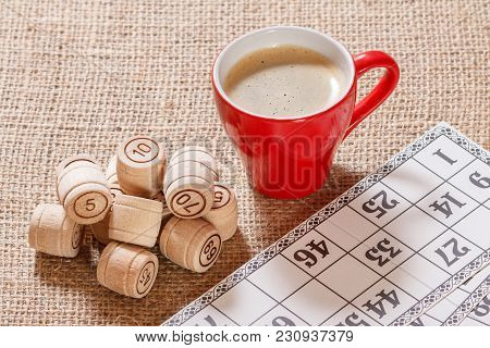 Board Game Lotto On Sackcloth. Wooden Lotto Barrels And Game Cards For A Game In Lotto With Cup Of C