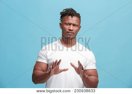 Young Afro-american Man With Disgusted Expression Repulsing Something, Isolated On The Blue