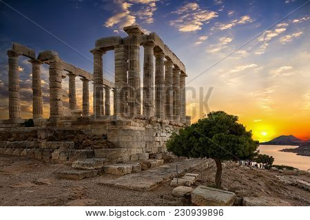 The Temple Of Poseidon Located At Sounion, Attica, Greece During Sunset