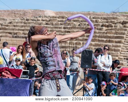 Caesarea, Israel, March 03, 2018 : A Participant Of The Purim Festival Shows A Performance With An I