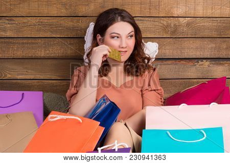 Woman After Shopping On Bed With Paper Bags, Bank Card