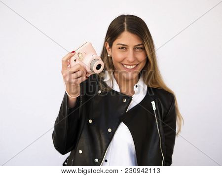 Woman Taking Pictures With Retro Style Camera