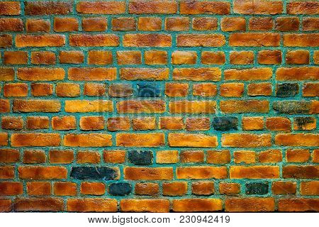 Dark And Light Yellow Brick Lacquered Wall. Color Background. Texture. Closeup.