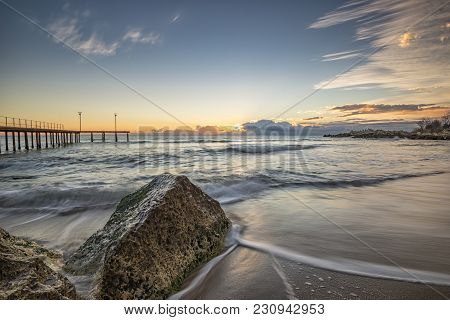 Sea Wave Motion Blur, Low Angle View, A Beautiful View With First Rays Over The Sea