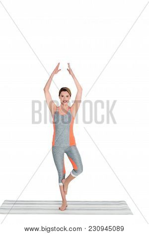 Woman In Sportswear Practicing Yoga Tree Pose Isolated On White