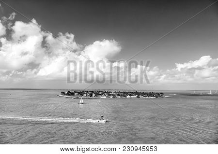 Cruise Touristic Boats Or Yacht Floating By Island With Houses And Green Trees On Turquoise Water An