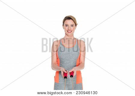 Portrait Of Smiling Sportswoman With Jumping Rope Isolated On White