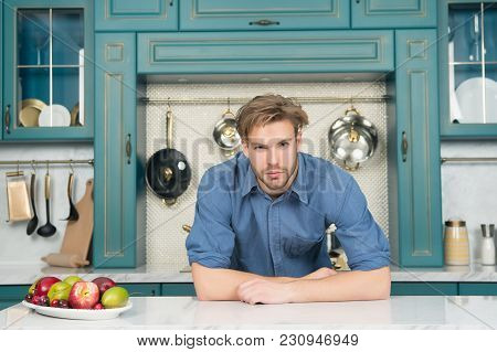 Bachelor With Fresh Fruit Plate On Table, Vitamin. Man With Beard In Blue Shirt In Kitchen, Cuisine.