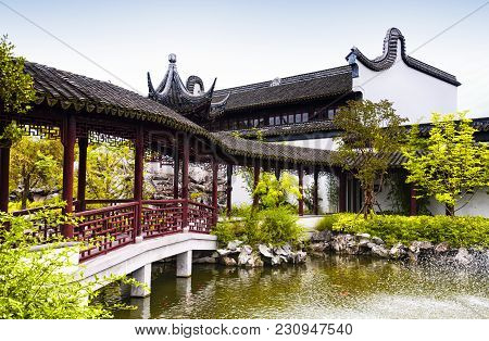 A Water Fountain And Covered Corridor At The Classical Chinese Li Yuan Garden In Zhaojialou In Shang
