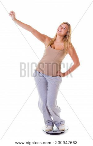 Diet, Fitness, Slimming, Loosing Weight Concept. Happy Blonde Woman Wearing Tracksuit Standing On We
