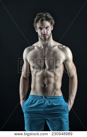 Sportsman With Sexy Chest, Belly, Six Pack, Ab, Biceps, Triceps. Man Athlete Show Muscular Torso In