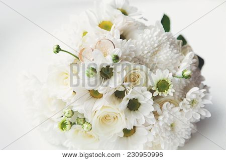 A Beautiful, Delicate Bridal Wedding Bouquet With Wedding Rings. Wedding Rings Are A Symbol Of Love