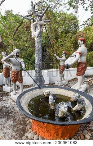 Statues Near The Killing Caves Of Phnom Sampeau At Battambang