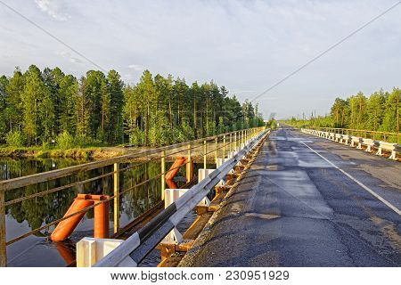 The Bridge Across The Siberian Taiga And The River.simple And Reliable Design