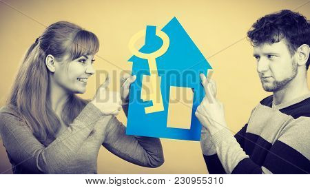 Dreaming And Buying House. Disagreement Concept. Young Couple Pair Have Different Opinion About Thei