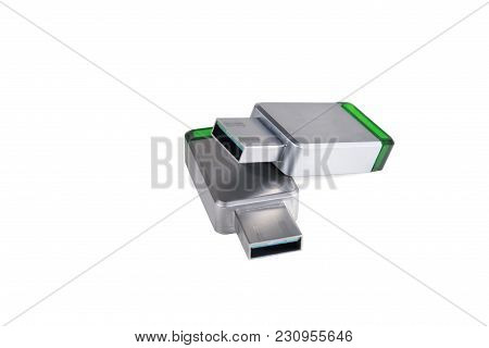 Usb Flash Drives In A Metal Case. Silvery Clerical Knife. Isolated On White Background.