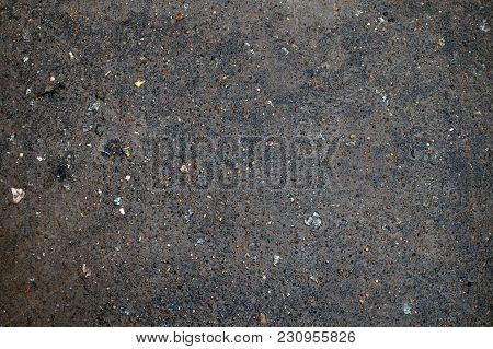 Texture Of A Wet Asphalt With Mud