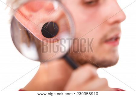 Stylish Teenage Boy Close Face Profile, Pierced Ear Black Plug Through The Magnifying Glass, Isolate