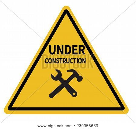 Under Construction Triangular Warning Sign On White Background. Under Construction Sign. Under Const
