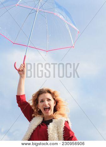 Happy Joyful Elegant Adult Woman Holding Transparent Umbrella Against Sky. Weather Forecasting Conce