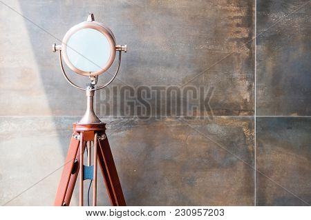 Set Of Retro Spotlights On Tripods In Grunge Wall Background With Copy Space And Text