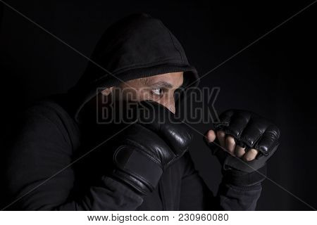 Portrait Of A Boxer In Fight Position. Soft Focus