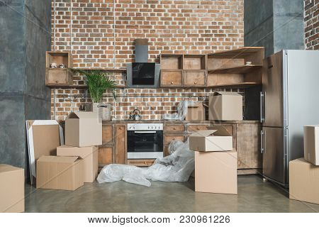Cardboard Boxes In Empty Kitchen During Relocation