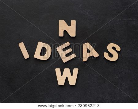 New Idea Phrase Spelled With Wooden Letters On Black Background. Inspiration, Creativity, Imaginatio