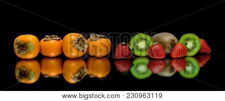 Persimmon, Kiwi And Strawberries On A Black Background. Horizontal Photo.