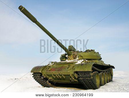 Green Russian Battle Tank T-55 On Winter Background
