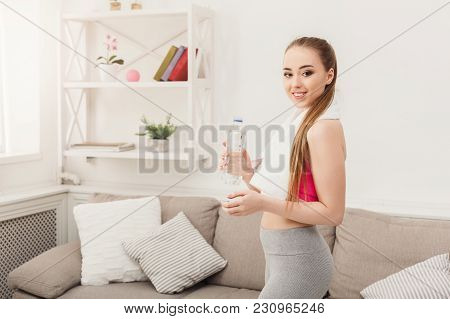 Happy Beautiful Young Sport Woman With Towel And Water. Confident Fitness Girl Holding Plastic Bottl