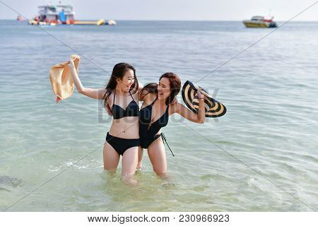 Sexy Girl Concept In Swimsuit. Beautiful Woman Wearing A Swimsuit Playing In The Beach. Girl In Sexy