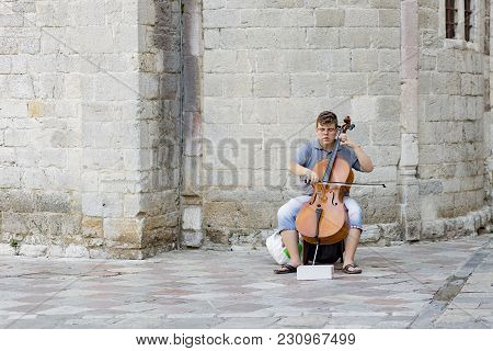 Montenegro Kotor August 14, 2017, The Boy Plays A Musical Instrument On The Street, Editorial
