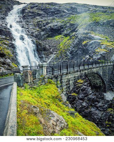 View On Bridge and Waterfall In Troll Road, Norway
