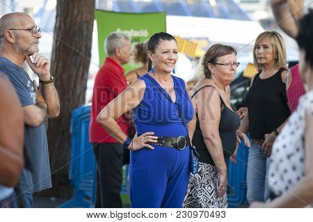 Barcelona, Spain - August 16, 2016 : Woman Is Watching Like People Dancing In The Square At The Port
