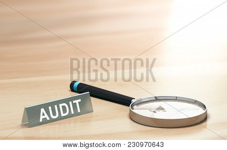 Magnifying Glass And A Sign With The Word Audit On A Wooden Table With Copyspace At The Background.