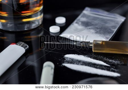 Different Drugs On Dark Background.
