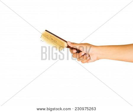 Hand Holding Hair Comb Isolated On White Background. A Comb Is A Toothed Device Used For Styling For
